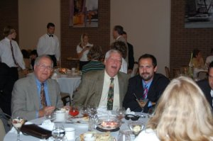 The author (far right) and his father (center) at a Bar Mitzvah in 2008