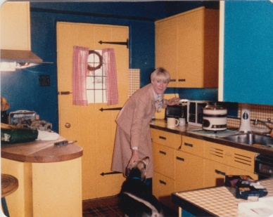 My mother in the yellow kitchen with Muffin.