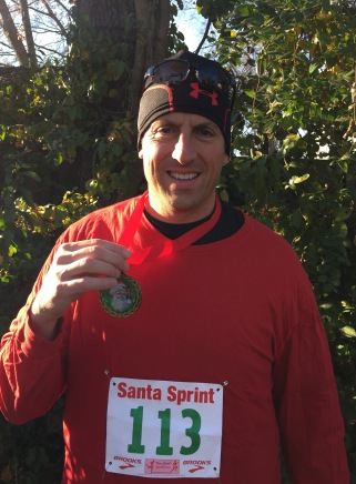 The author at the finish line with his Santa Sprint medal